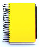 Yellow blank notebook Royalty Free Stock Images