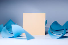 Yellow blank sheet for records amid swirling blue sheets lying royalty free stock image