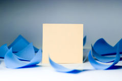 Yellow blank sheet for records amid swirling blue sheets lying stock photo
