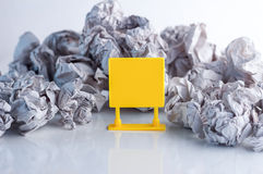 Yellow blank signage for your text and trash paper balls Royalty Free Stock Images
