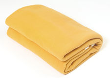 Yellow blanket. Against a white background Stock Images