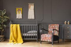Yellow blanket on bed in kid`s bedroom interior with patterned a Stock Image