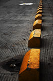 Yellow Blocks. Yellow concrete blocks marking off parking places Royalty Free Stock Photography