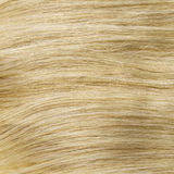 Yellow blonde healthy clip-in hair texture Royalty Free Stock Photos