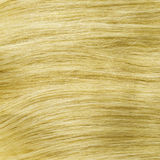 Yellow blonde healthy clip-in hair texture Stock Photo