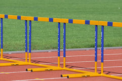 Yellow and blu hurdles Stock Photos