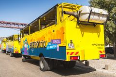Yellow blue amphibian bus, rear view Stock Images