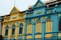 Yellow and blue art deco Peranakan colorful architecture houses Hat Yai Thailand. Hat Yai, Thailand - August 30, 2015: Two peranakan style designed houses on a royalty free stock photo