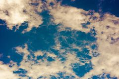 Yellow blue background with clouds in the sky royalty free stock photos