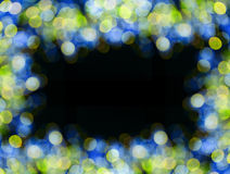 Yellow and blue background frame with bokeh lights on black Stock Photos