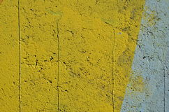 Yellow and blue background. Rough concrete wall painted in yellow and blue colors Royalty Free Stock Images