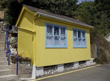 Yellow and blue beach hut, Jersey. Beach hut at Rozel Bay, Jersey, Channel Islands, Great Britain Stock Images