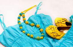 Yellow blue beads on dress and shoes Royalty Free Stock Image