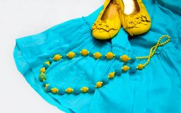 Yellow blue beads on dress and shoes Royalty Free Stock Images