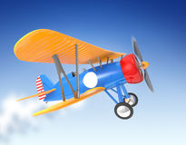 Yellow and blue biplane flying in the sky Royalty Free Stock Images
