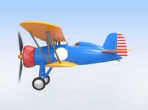 Yellow and blue biplane flying in the sky Stock Image