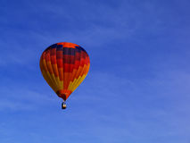 Yellow Blue and Black Hot Air Balloon Under Clear Blue Sky Royalty Free Stock Images