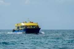 Yellow and blue boat in the mexican caribbean royalty free stock photo