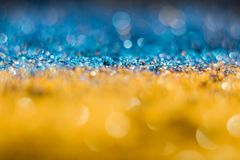 Yellow-blue bokeh on a black background. Defocused. Patriotic Yellow-blue bokeh on a black background. The Ukrainian flag. Defocused. Free space for text stock photo