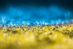Yellow-blue bokeh on a black background. Defocused. Patriotic Yellow-blue bokeh on a black background. The Ukrainian flag. Defocused. Free space for text royalty free stock images