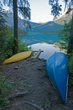 Yellow and blue canoes at emerald lake Stock Images