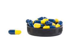 Yellow and blue Capsule white background. Yellow and blue Capsule on white background Stock Image