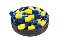 Yellow and blue Capsule on the white background. Yellow and blue Capsule on white background Stock Photo