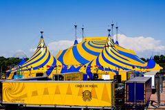 A yellow and blue circus tent.
