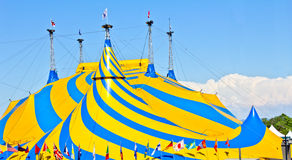 A yellow and blue circus tent. Royalty Free Stock Photo