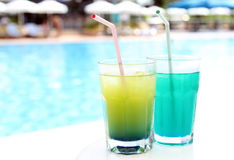 Yellow and blue cocktail near swimming pool Royalty Free Stock Images