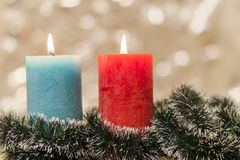 Yellow and blue colourful candles with blurred bokeh background. Stock Photo