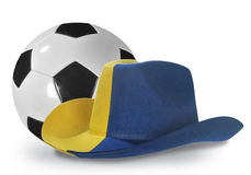 Yellow-blue cowboy hat and soccer ball Royalty Free Stock Photography