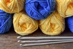 Yellow and Blue Crochet Yarn. A close up image of a yellow and blue crochet yarn and metal crochet hooks Stock Photo