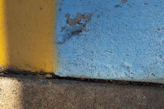 Yellow and blue curbside Stock Images