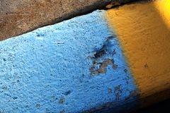 Yellow and blue curbside. Blue and yellow painted stones Royalty Free Stock Images