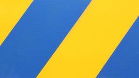 Yellow and Blue diagonal hazard stripes Stock Photos