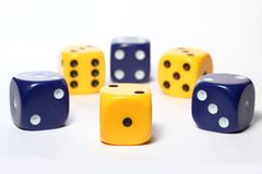 Yellow and blue dice Royalty Free Stock Images