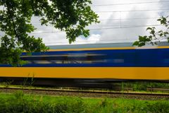 A yellow and blue Dutch train stock image
