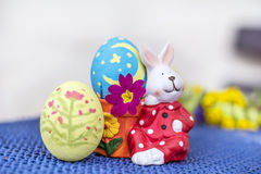 Yellow and blue  easter  bunny eggs  egg with pink flower Royalty Free Stock Photos