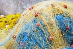 Yellow and blue  fishing net Royalty Free Stock Images