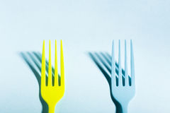 Yellow and blue forks on blue background Stock Images