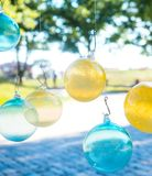 Glass balls hanging from fish hooks Stock Image