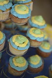 Yellow, blue and green cupcakes Royalty Free Stock Photography