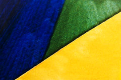 Paper background. A close-up of multi coloured paper Stock Images