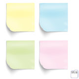 Yellow, blue, green and pink memo sticks isolated on white backg. Round Stock Image