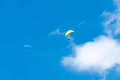 Yellow and Blue Hang Gliders Royalty Free Stock Photography