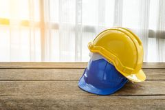 Yellow, blue hard safety helmet construction hat for safety proj Stock Photo