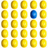 Yellow and blue hardhats on white background Stock Photography