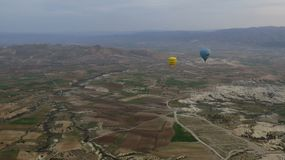 Yellow and Blue Hot Air Balloons Flying Over Cappadocia royalty free stock photo