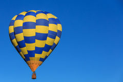 Yellow and Blue hot air balloons in the sky. Royalty Free Stock Photos